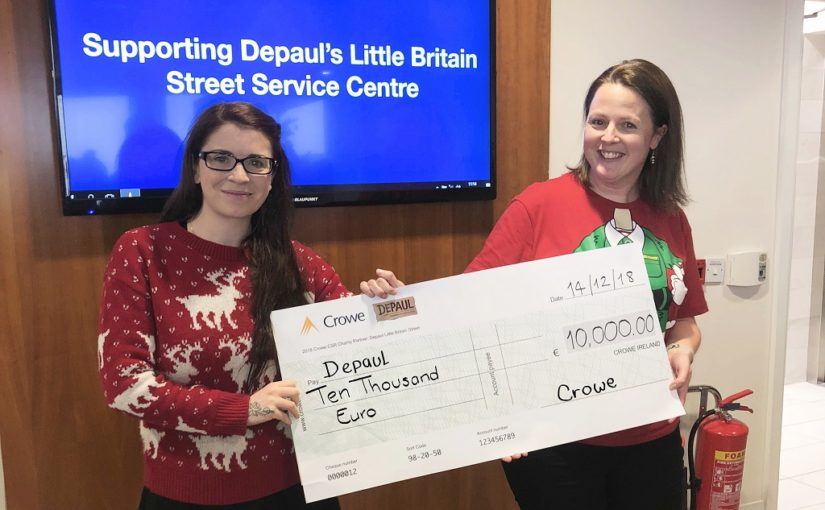 Crowe Ireland staff present fundraising cheque to Depaul